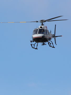 A helicopter flying over the township.