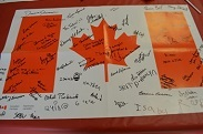 Canadian flag with signatures.